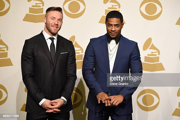 NFL players Julian Edelman and Malcolm Butler pose in the Deadline Photo Room during The 57th Annual GRAMMY Awards at the STAPLES Center on February...