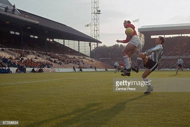 Players jump for the ball at Hillsborough stadium as Argentina play Switzerland in a Group B match during the 1966 World Cup in England 19th July...