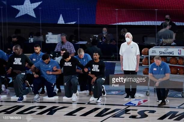 Players kneel before an NBA basketball game between the San Antonio Spurs and the Memphis Grizzlies, at Visa Athletic Center at ESPN Wide World Of...