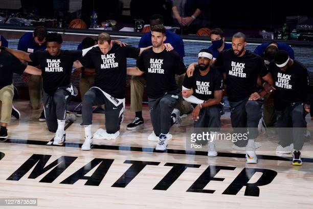 Players kneel before an NBA basketball game between the Utah Jazz and Oklahoma City Thunder on August 1 in Lake Buena Vista, Florida. NOTE TO USER:...