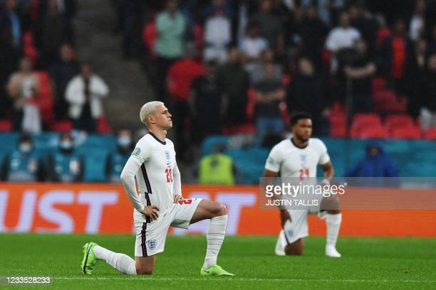 Players kneel down against racism before the UEFA EURO 2020 Group D football match between England and Scotland at Wembley Stadium in London on June...