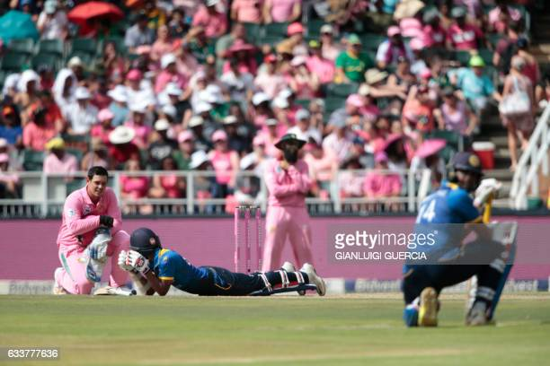 Players lay low as a swarm of bees storm the field during the third One Day International match between South Africa and Sri Lanka at Wanderers...