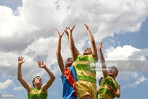 players leaping to catch football - afl stock pictures, royalty-free photos & images