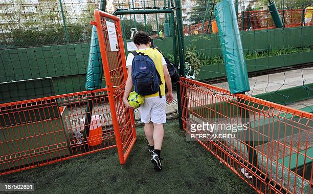Players leave a pictch afer competing a fiveaside football match on April 24 2013 in Puteaux outside Paris AFP PHOTO PIERRE ANDRIEU