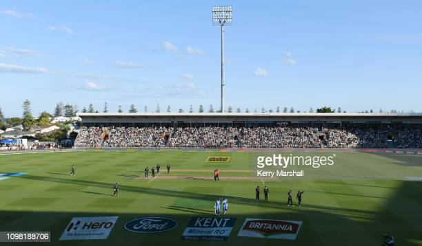 Players leave the field due to glare from the sun during game one of the One Day International series between New Zealand and India at McLean Park on...