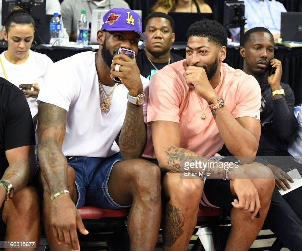 Players LeBron James and Anthony Davis talk as they watch a game between the New Orleans Pelicans and the New York Knicks during the 2019 NBA Summer...