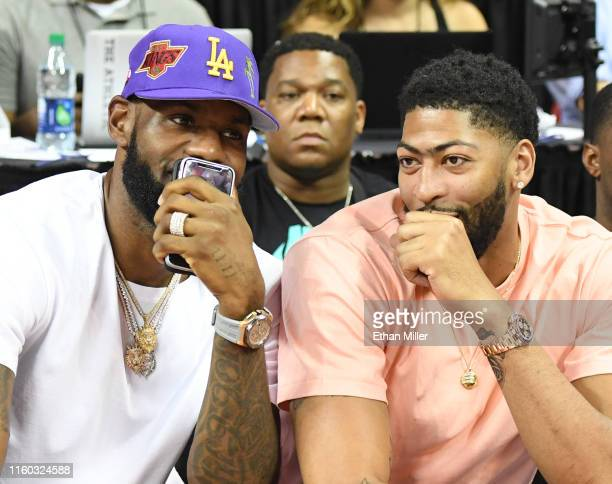NBA players LeBron James and Anthony Davis talk as they watch a game between the New Orleans Pelicans and the New York Knicks during the 2019 NBA...
