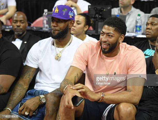 NBA players LeBron James and Anthony Davis watch a game between the New Orleans Pelicans and the New York Knicks during the 2019 NBA Summer League at...