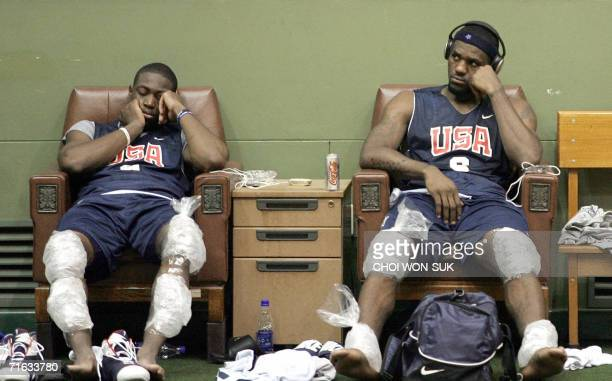 US players LeBron James and Dwyane Wade cool their muscles with ice packs at a training session for the World Basketball Challenge 2006 in Seoul 12...