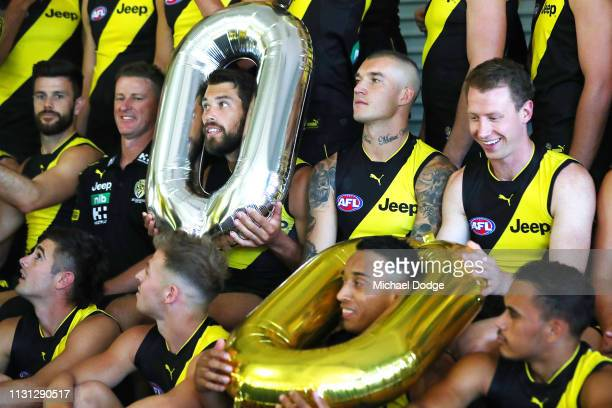 Players like Alex Rance of the Tigers have fun with balloons during the AFL Richmond Tigers team photo session at Punt Road Oval on February 22 2019...