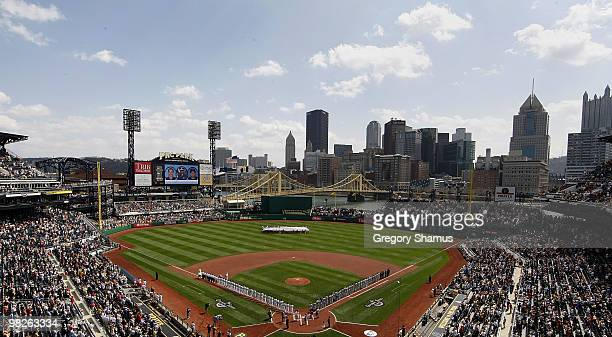 Players line the base paths of PNC Park during the National Anthem prior to the Pittsburgh Pirates playing the Los Angeles Dodgers in the Home Opener...