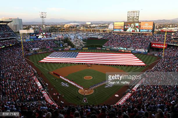 Players line the field during pre-game festivities on Opening Day before a baseball game between the Los Angeles Angels and Chicago Cubs at Angel...