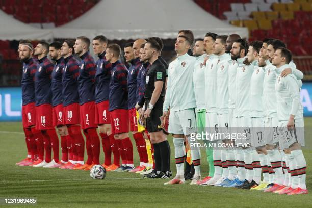 Players line up ahead of the FIFA World Cup Qatar 2022 qualification Group A football match between Serbia and Portugal at the Rajko Mitic Stadium,...