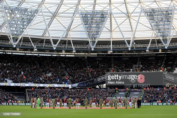 Players line up around the centre circle for a minute's silence ahead of Armistice day prior to the Premier League match between West Ham United and...