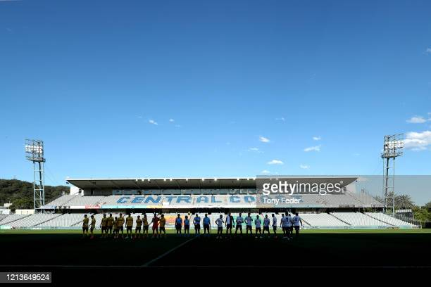 Players line up before the start of the game during the round 24 A-League match between the Central Coast Mariners and Melbourne City at Central...