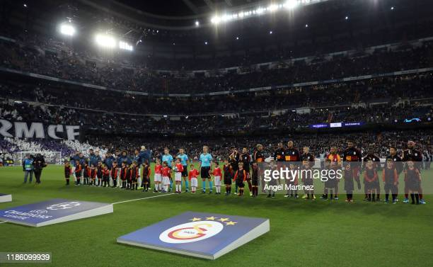 Players line up before the UEFA Champions League group A match between Real Madrid and Galatasaray at Bernabeu on November 06, 2019 in Madrid, Spain.