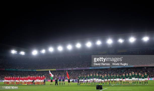Players line up during the presentation prior to the Rugby World Cup 2019 SemiFinal match between Wales and South Africa at International Stadium...