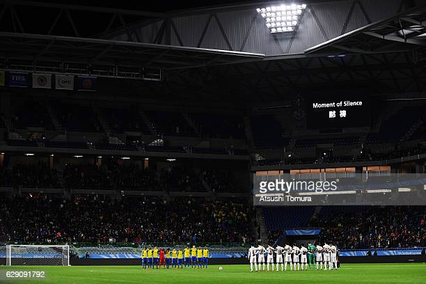 Players line up for a minute of silence in memory of the members of the Brazillian soccer team Chapecoense who died in a plane crash before the FIFA...
