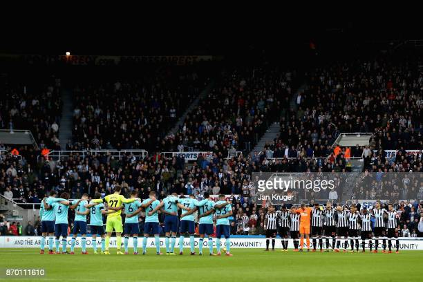 Players line up for a minute's silence ahead of Remembrance Sunday prior to the Premier League match between Newcastle United and AFC Bournemouth at...