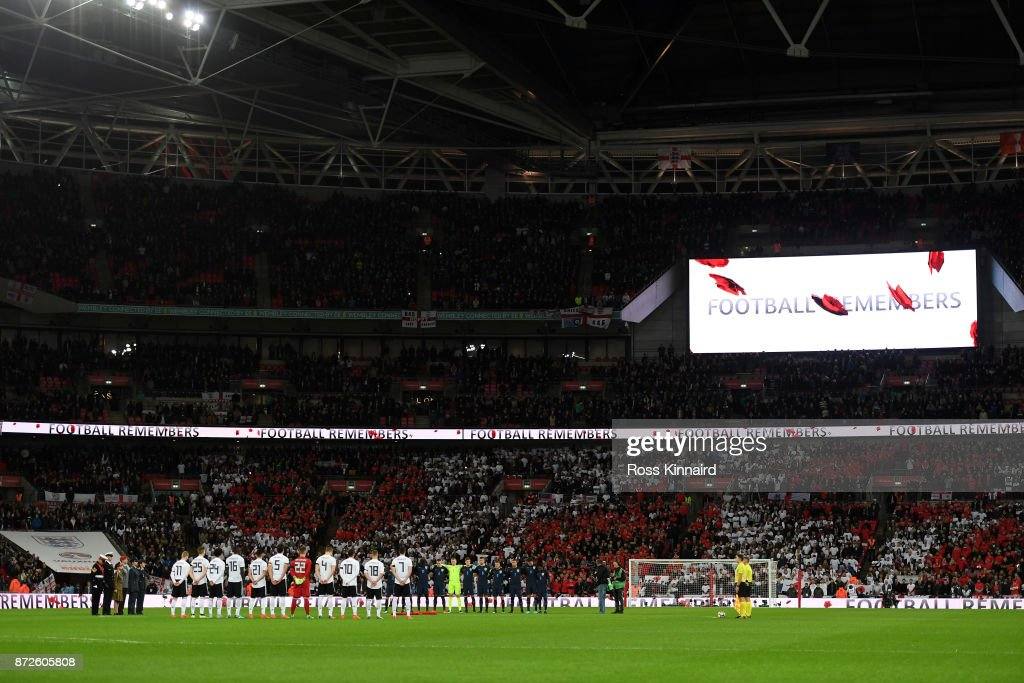 Players line up for a minute's silence ahead of Remembrance Sunday prior to the International friendly match between England and Germany at Wembley Stadium on November 10, 2017 in London, England.