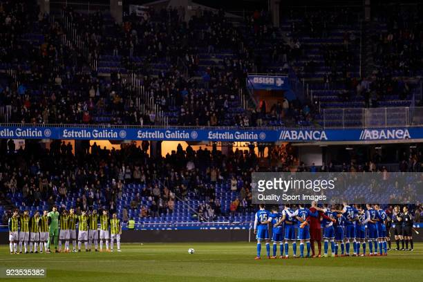 Players line up for a minute's silence in tribute to Inocencio Alonso Garcia ahead prior to during the La Liga match between Deportivo La Coruna and...
