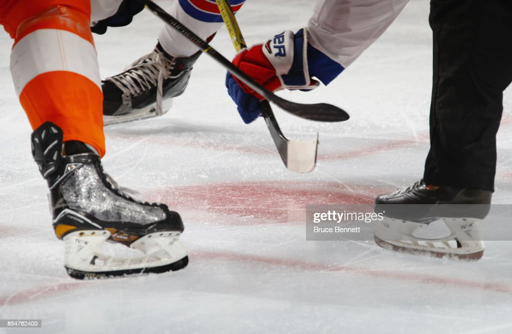 Players line up for a puck drop between the Philadelphia Flyers and the New York Rangers during a preseason game at the Wells Fargo Center on September 26, 2017 in Philadelphia, Pennsylvania.