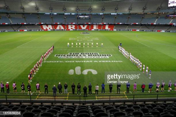 Layers line up for the acknowledgement of country before the round 11 AFL match between the St Kilda Saints and the North Melbourne Kangaroos at...