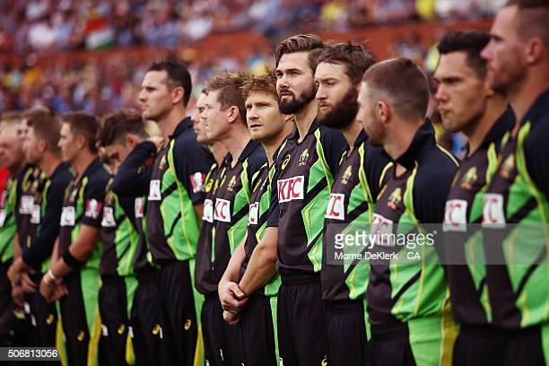 Players line up for the anthem ceremony before game one of the Twenty20 International match between Australia and India at Adelaide Oval on January...