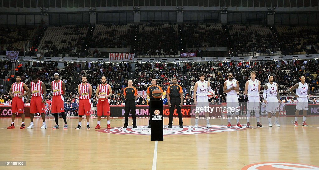 Players line up for the group photo during the Euroleague ...