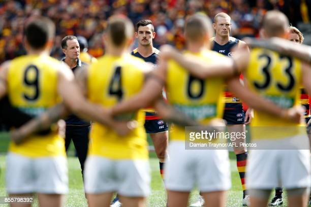 Players line up for the national anthem before the 2017 AFL Grand Final match between the Adelaide Crows and the Richmond Tigers at Melbourne Cricket...