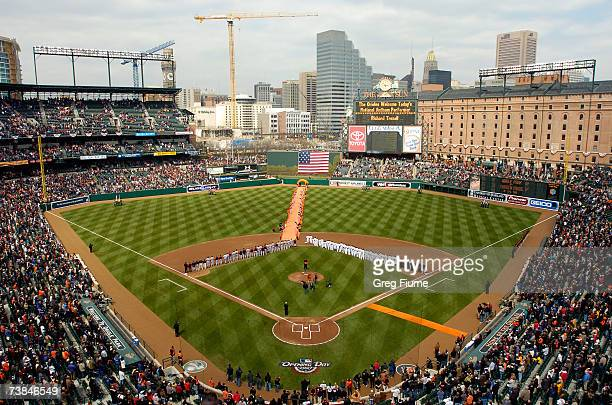 Players line up for the National Anthem before the Baltimore Orioles home opener against the Detroit Tigers at Camden Yards April 9 2007 in Baltimore...