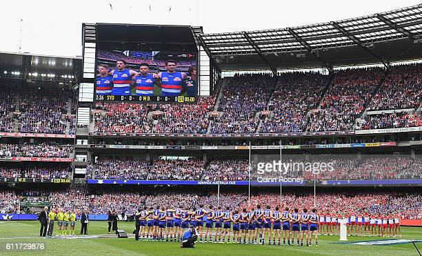 Players line up for the national anthem during the 2016 AFL Grand Final match between the Sydney Swans and the Western Bulldogs at Melbourne Cricket...
