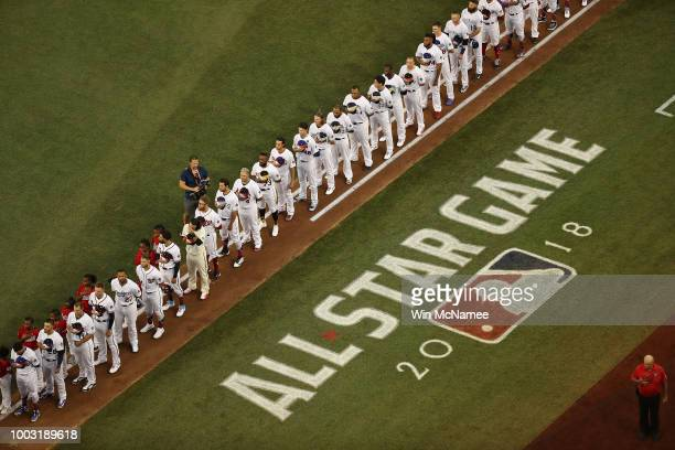 Players line up for the national anthem prior the 89th MLB All-Star Game, presented by Mastercard at Nationals Park on July 17, 2018 in Washington,...