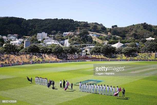 Players line up for the national anthems during day one of the Test match series between the New Zealand Blackcaps and the West Indies at Basin...