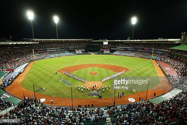 Players line up for the national anthems during the opening match of the MLB season between the Los Angeles Dodgers and the Arizona Diamondbacks at...