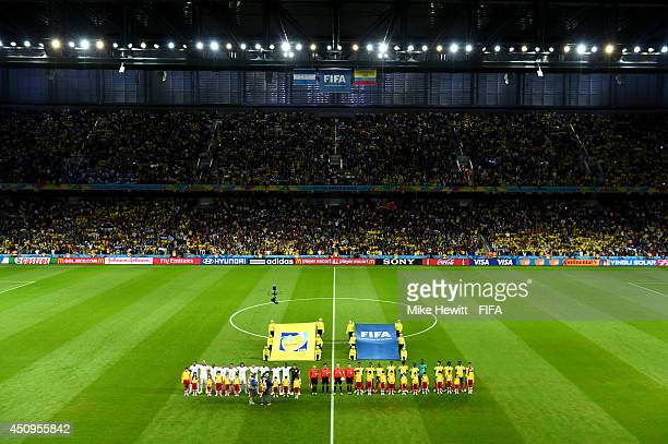 Players line up for the national anthems prior to the 2014 FIFA World Cup Brazil Group E match between Honduras and Ecuador at Arena da Baixada on...