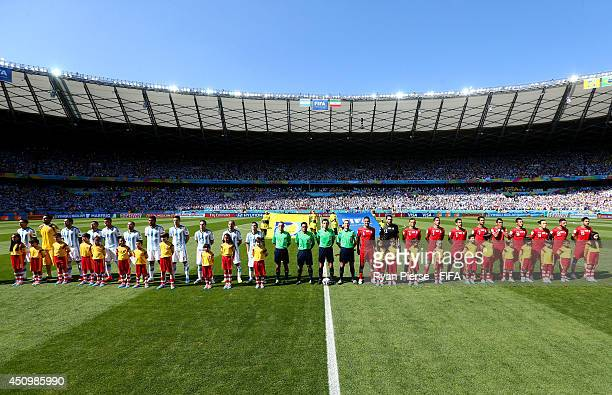 Players line up for the national anthems prior to the 2014 FIFA World Cup Brazil Group F match between Argentina and Iran at Estadio Mineirao on June...
