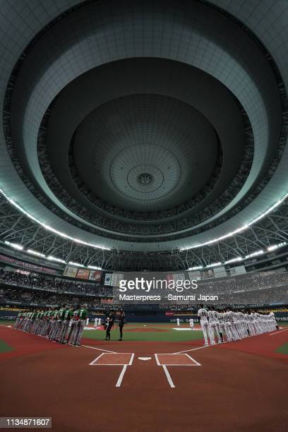 Players line up for the national anthems prior to the game two between Japan and Mexico at Kyocera Dome Osaka on March 10 2019 in Osaka Japan