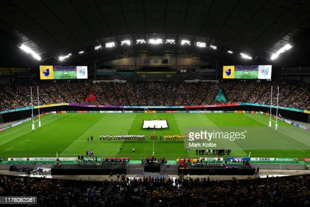 Players line up for the national anthems prior to the Rugby World Cup 2019 Group D game between Australia and Fiji at Sapporo Dome on September 21,...