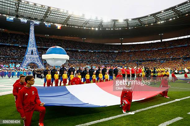 Players line up for the national anthems prior to the UEFA Euro 2016 Group A match between France and Romania at Stade de France on June 10 2016 in...