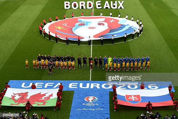 Players line up for the national anthems prior to the UEFA EURO 2016 Group B match between Wales and Slovakia at Stade Matmut Atlantique on June 11...