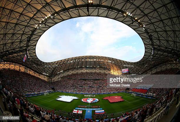 Players line up for the national anthems prior to the UEFA EURO 2016 Group B match between England and Russia at Stade Velodrome on June 11, 2016 in...