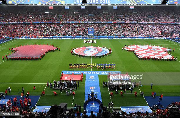 Players line up for the national anthems prior to the UEFA EURO 2016 Group D match between Turkey and Croatia at Parc des Princes on June 12 2016 in...