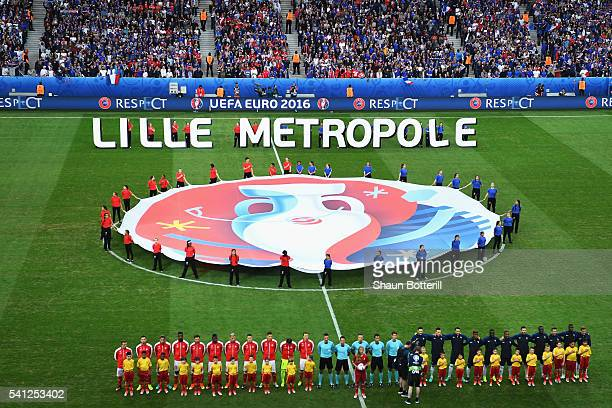 Players line up for the national anthems prior to the UEFA EURO 2016 Group A match between Switzerland and France at Stade Pierre-Mauroy on June 19,...