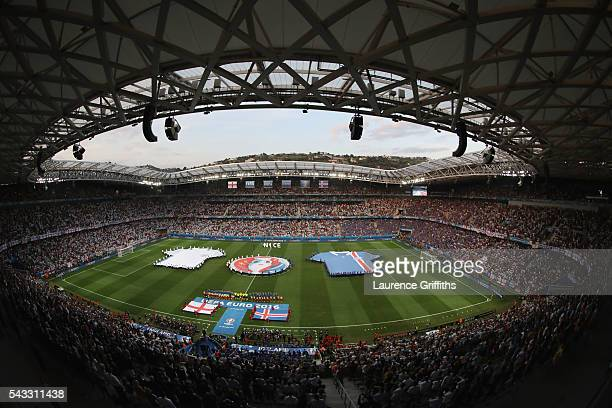 Players line up for the national anthems prior to the UEFA EURO 2016 round of 16 match between England and Iceland at Allianz Riviera Stadium on June...