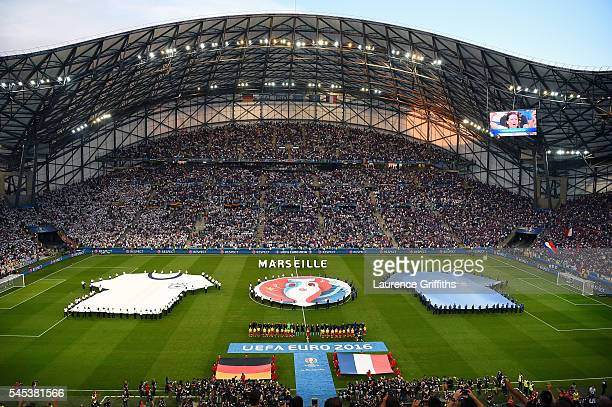 Players line up for the national anthems prior to the UEFA EURO semi final match between Germany and France at Stade Velodrome on July 7 2016 in...