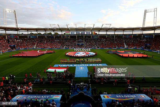 Players line up for the team photos prior to the UEFA EURO 2016 round of 16 match bewtween Hungary and Belgium at Stadium Municipal on June 26 2016...