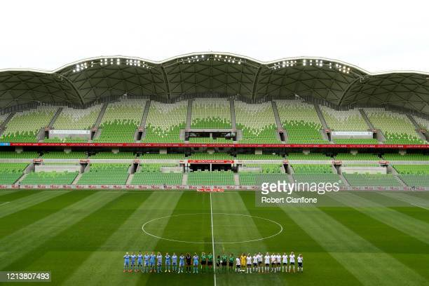 Players line up in front of an empty stadium ahead of the 2020 W-League Grand Final match between Melbourne City and Sydney FC at AAMI Park on March...