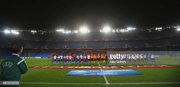Players line up in the empty stadium prior to the UEFA Europa League Quarter Final first leg match between FC Basel 1893 and FC Valencia at St...