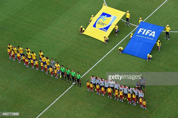 Players line up on the field before the 2014 FIFA World Cup Brazil Group A match between Brazil and Mexico at Castelao on June 17 2014 in Fortaleza...